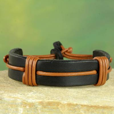 Men's leather wristband bracelet, 'Enduring Strength' - Men's Brown and Black Leather Wristband Bracelet from Ghana
