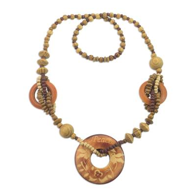 Wood pendant necklace, 'Peaceful Birds' - Handcrafted Sese Wood Beaded Pendant Necklace from Ghana
