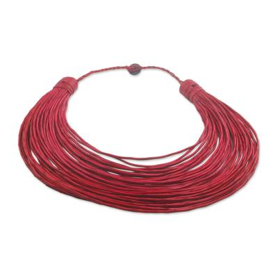 Leather statement necklace, 'Siklafi' - Handmade Red Leather Strand Statement Necklace from Ghana