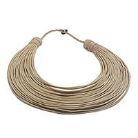 Leather statement necklace, 'Buudu' - Handmade Beige Leather Strand Statement Necklace from Ghana
