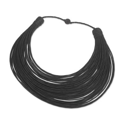 Leather statement necklace, 'Bayala' - Handmade Black Leather Strand Statement Necklace from Ghana