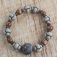 Men's terracotta and wood beaded stretch bracelet, 'Bold Adventurer'