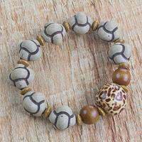 Wood beaded stretch bracelet, 'Pattern Play' - Hand Made Earth Tone West African Wood Bead Stretch Bracelet