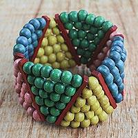 Wood beaded stretch bracelet, 'Dynamic Color' - Colorful Wood Bead Stretch Bracelet Hand Made West Africa