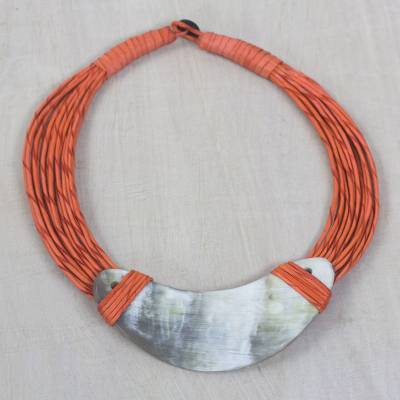 Horn pendant necklace, 'Somo' - Crescent-Shaped Horn Pendant Orange Leather Cord Necklace