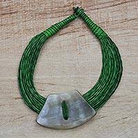 Horn pendant necklace, 'Zodoo' - Trapezoid-Shaped Horn Pendant Green Leather Cord Necklace