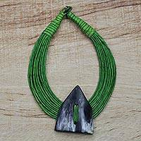 Horn pendant necklace, 'Zinlafa' - Triangle-Shaped Horn Pendant Green Leather Cord Necklace