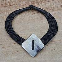 Horn pendant necklace, 'Pamga' - Diamond-Shaped Horn Pendant Black Leather Cord Necklace
