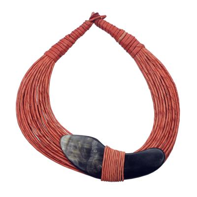 Horn pendant necklace, 'Tuumsongo' - Boomerang Horn Pendant Orange Leather Cord Necklace