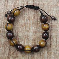 Wood beaded bracelet, 'Lively Shades' - Adjustable Sese Wood Beaded Bracelet from Ghana