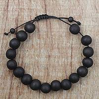 Ebony wood beaded bracelet, 'Chic Silhouettes' - Adjustable Ebony Wood Beaded Bracelet from Ghana