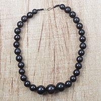 Ebony wood beaded necklace, 'Elegant Circle'