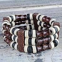 Wood beaded stretch bracelet, 'Adeshi' - Black and White Natural Sese Wood Beaded Stretch Bracelet