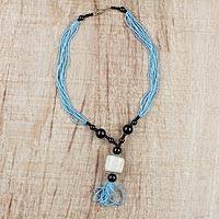 Horn and recycled glass beaded pendant necklace, 'Mother's Embrace' - Sky Blue and Black Beaded Glass Horn Pendant Necklace