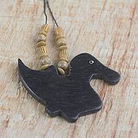 Wood pendant necklace, 'Wild Duck' - Handmade Wood Beaded Pendant Duck Necklace from Ghana