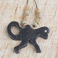 Wood pendant necklace, 'Wild Monkey' - Handmade Wood Beaded Pendant Monkey Necklace from Ghana