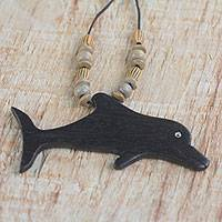 Wood pendant necklace, 'Wild Dolphin' - Handmade Wood Beaded Pendant Dolphin Necklace from Ghana