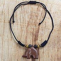 Wood pendant necklace, 'Faithful Elephant' - Hand Carved Sese Wood African Elephant Cord Necklace