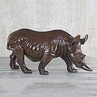 Ebony wood sculpture, 'Roaming Rhino' - Ghanaian Artisan Handcarved Ebony Wood Rhinoceros Sculpture