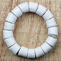 Recycled glass beaded stretch bracelet, 'Regal Manye' - White Recycled Glass Beaded Stretch Bracelet from Ghana