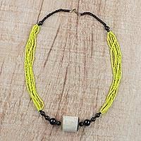 Horn and recycled glass beaded pendant necklace, 'Graceful Sunshine' - Yellow and Black Beaded Glass Horn Pendant Necklace