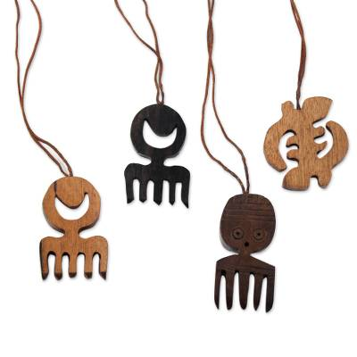 Ebony wood ornaments, 'Adinkra Passion' (set of 4) - Ebony Wood Adinkra Ornaments from Ghana (Set of 4)