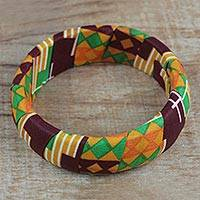 Wood and cotton bangle bracelet, 'Cheerful Sunrise' - Wrapped Cotton Print Bangle Bracelet in Green and Orange