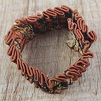 Cotton wristband bracelet, 'Akwaaba' - Brown and Orange Ruched Abstract Cotton Fabric Bracelet