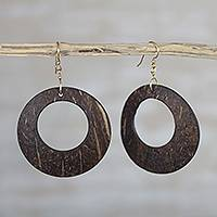Coconut shell dangle earrings, 'Natural Loop' - Handcrafted Coconut Shell Dangle Earrings from West Africa