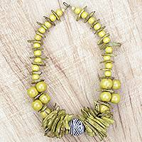 Wood and coconut shell beaded statement necklace, 'Yellow Splendor' - Yellow Sese Wood and Coconut Shell Statement Necklace