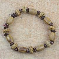 Wood beaded stretch bracelet, 'Accra Rings' - Natural Sese Wood Beaded Stretch Bracelet from Ghana