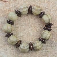 Wood beaded stretch bracelet, 'Happy Circles' - Circular Sese Wood Beaded Stretch Bracelet from Ghana