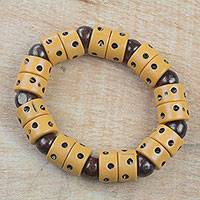 Wood and recycled plastic beaded stretch bracelet, 'Apple of Meniwa' - Dot Motif Wood and Plastic Stretch Bracelet from Ghana
