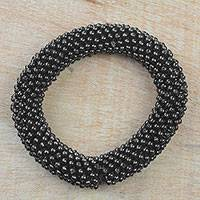 Recycled plastic beaded stretch bracelet, 'Dark Bubbles' - Black Recycled Plastic Beaded Stretch Bracelet from Ghana