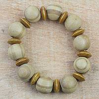 Wood beaded stretch bracelet, 'Natural Circles' - Light Brown Sese Wood Beaded Stretch Bracelet from Ghana