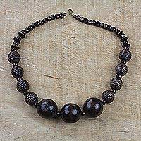 Wood beaded pendant necklace, 'Great Tribe' - Dark Sese Wood Beaded Pendant Necklace from Ghana