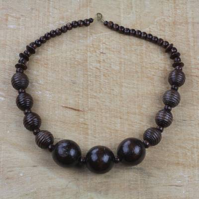 Wood beaded pendant necklace, 'Great Tribe' - Dark Sese Wood Beaded Pendant Necklace from Ghana