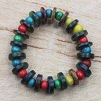 Wood beaded stretch bracelet, 'Zeal' - Multi-Color Wood Bead and Disc Stretch Bracelet