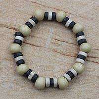 Wood beaded stretch bracelet, 'Fellowship' - Black and Cream Wood Bead and Disc Stretch Bracelet