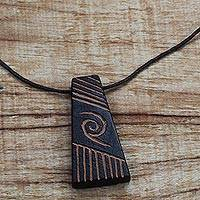 Wood pendant necklace, 'Spiral Galaxy' - Long Sese Wood Pendant Necklace Hand Crafted in Ghana