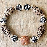 Ceramic and wood beaded stretch bracelet, 'Fanosaa' - Ceramic and Wood Beaded Stretch Bracelet from Ghana