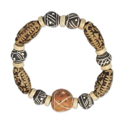 Ceramic and wood beaded stretch bracelet, 'Fanosaa' - Ceramic and Wood Beaded Stretch Bracelet from Ghana