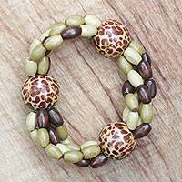 Wood beaded stretch bracelet, 'Cheetah Fashion' - Cheetah Motif Sese Wood Beaded Stretch Bracelet from Ghana