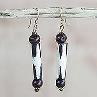 Wood and bone dangle earrings, 'Journey's End' - Black and White Bone and Sese Wood Long Dangle Earrings