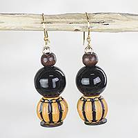 Wood and recycled plastic dangle earrings, 'Harvest Gourd' - Orange Black Recycled Plastic Harvest Gourd Dangle Earrings