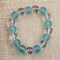 Recycled glass beaded stretch bracelet, 'Beautiful Ice' - Clear and Blue Recycled Glass Beaded Stretch Bracelet