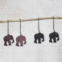 Ebony wood ornaments, 'Trunk Bearers' (set of 4) - Handcrafted Ebony Wood Elephant Ornaments (Set of 4)