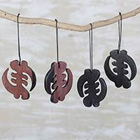 Ebony wood ornaments, 'Akan Belief' (set of 4) - Handcrafted Ebony Wood Gye Nyame Ornaments (Set of 4)