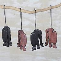 Ebony wood ornaments, 'Jungle Jaunt' (set of 4) - Handcrafted Ebony Wood Walking Elephant Ornaments (Set of 4)