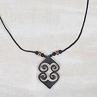 Wood pendant necklace, 'Asase Ye Duru' - Adinkra Asase Ye Duru Sese Wood Pendant Necklace from Ghana